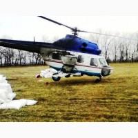 Розсіювання селітри вертольотом